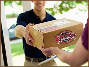 Photo of Johnston's Meat Market box being delivered to a home