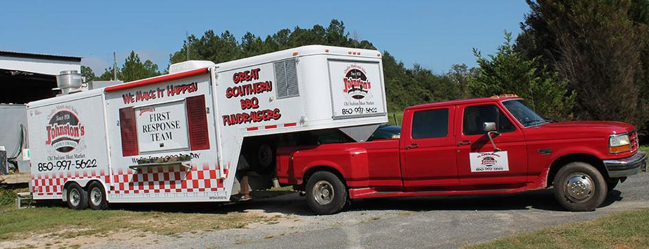 Photo of Johnston's red truck and mobile kitchen.
